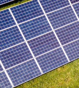 Second part of solar panels in green meadow